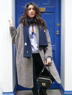 layer up like a pro this winter as shown by Kavita, fashion blogger, wearing our star print cashmere scarf.