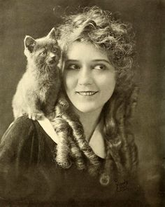 MARY PICKFORD sharing some time with a feline friend.