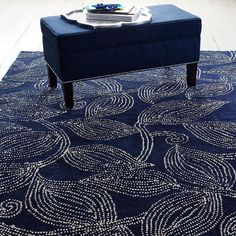 Shadow Leaf Rug / Rug Grip - This beautiful wool rug borrows its pointillist look from the traditional henna tattoos Indian brides wear on their hands and feet.