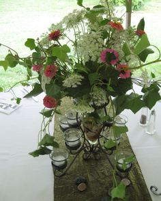 our vase looks great on a table with those gorgeous flowers! via First Fruits Catering #puttogooduse #kirklands