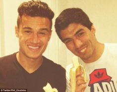 We're all the same: Philippe Coutinho and Luis Suarez show their support for Alves with the banana protest