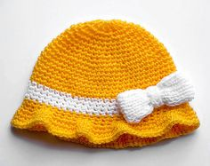 Hand Knit Yellow Baby Cap with white bow. Baby Hat. by CatANeedle