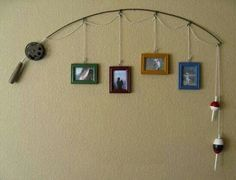 Old fishing pole. Hang a photo frame from each loop.