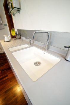 Corian moulded sinks in white with silver grey top and Quooker Nordic Square Twintaps
