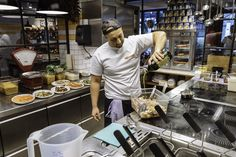 Kitchen staff preparing salad| L'Osteria | Pizza E Pasta