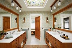 The spacious washroom leads to a separate shower and toilet. A cabin aesthetic, locally crafted, shows up in knotty-pine vanities and new skylights by Century Studios in St. Paul. This one is Spring; another one celebrates Autumn.