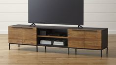 Looks like we all like the Rigby Media Console with Base from Crate and Barrel... a great possibility and it'd fit your space beautifully. The wood fronts will warm up the space nicely and provide ample closed storage which is great for keeping the space visibly tidy.