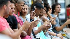 Cubans using their mobile devices in Havana, Cuba.