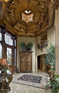 Hexagonal Mediterranean Foyer with incredible woodwork...
