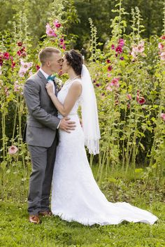 Barn & Garden wedding close to Salem, Oregon. Hollyhocks bride and groom
