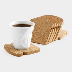 Fun toast-shaped cork comes packaged like a loaf of multigrain bread and is designed to be used as coasters and trivets. via MoMA Store The Coasters, Drink Coasters, Funny Coasters, 3d Laser Printer, Moma Store, Gravure Laser, Ideias Diy, Coaster Furniture, Deco Design