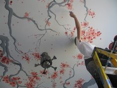 Cherry blossoms painted on a ceiling are unique and gorgeous.  Anyone up for me painting this in their home?