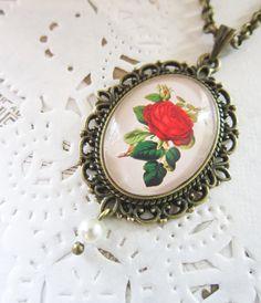 Red Rose Necklace -  Antique Bronze Cabochon Pendant. £11.00, via Etsy.