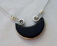 silver and ebony handmade pendant by Alejandra Giannoni