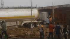 Tanker Loaded With Fuel Jumps Over Gutter, Crashes Into Shops In Calabar (Photos) - http://www.77evenbusiness.com/tanker-loaded-with-fuel-jumps-over-gutter-crashes-into-shops-in-calabar-photos/