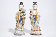 Two large Chinese famille rose candle holders modelled as court ladies, Qianlong