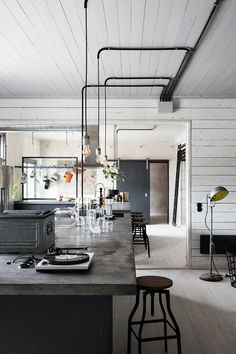 Concrete might seem like an unusual choice for your kitchen, but given the right setting, its rustic, textured look can set just the right tone