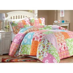 @Overstock - This multi-colored floral quilt set would be perfect for a young girls room. The quilt is available in twin or full sizes and includes one sham in the twin set and two shams in the full-sized set. The 100 percent cotton bedding is machine washable.http://www.overstock.com/Bedding-Bath/Aloha-Girls-Multicolor-Printed-100-percent-Cotton-3-Piece-Quilt-Set/5036546/product.html?CID=214117 $94.99