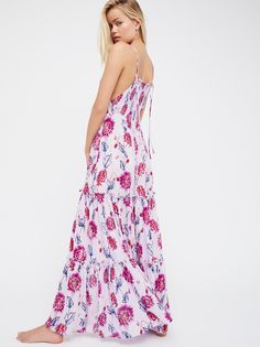 Garden Party Maxi Dress | Femme floral printed maxi dress featuring a stretchy smocked bodice and an effortless silhouette.  * Adjustable tie straps * Tiered design * Lightweight, semi-sheer fabrication