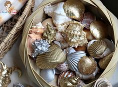 Gilding seashells - she used the Martha Stewart brand, which comes in four colors at the craft store -- gold, brass, copper and silver. she used brass and silver to create the seashells. Or use the glue and sheet method - and if you don't want it to tarnish over time SEAL it