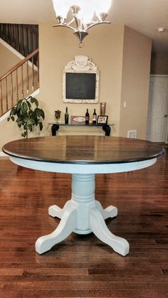 Beautiful solid oak table. The base done in Manor White mudpaint and finished with a dark Kona stain on top.