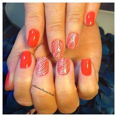 Orange Nails with White Designs