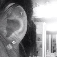 Cross cartilage earring.  I want to do this but I am scared.......@Nikyla Wardrop, will you come hold my hand??  LOL