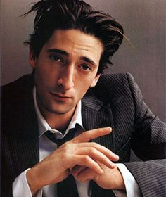 Adrien Brody.  I know he's got quite the beak but I still find him incredibly attractive. <3