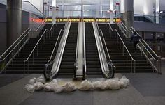 With only a security officer in the station, sandbags block the entry to the closed Staten Island Ferry in New York Monday, Oct. 29, 2012, all public transportation has been shut down as Hurricane Sandy approaches the East Coast. Hurricane Sandy continued on its path Monday, forcing the shutdown of mass transit, schools and financial markets, sending coastal residents fleeing, and threatening a dangerous mix of high winds and soaking rain.Ê(AP Photo/Craig Ruttle)