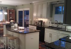 Great Northern cabinets in Commerce, MI from www.mikitchencabinets.com  backsplash and tan brown granite by www.trustedimprovement.com