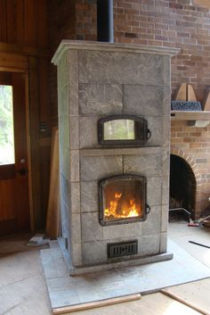 Soapstone fireplaces with ovens for cooking.