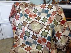 Elizabeth is a central circle of stars and is made of 1800s fabrics.