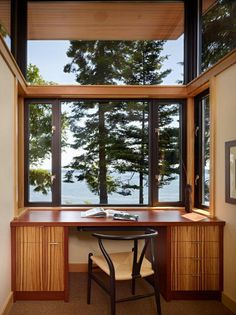The latest house by Nils Finne is perched on the shore of the Hood Canal, a long, fjord-like ar...