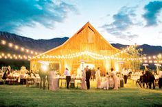 Love the lights strung outside the barn for a Summer wedding