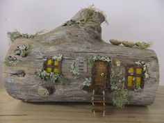 Old log fairy house - Great idea. If it is hollow, you could make actual wee windows and use solar lights to light it up. And the decapitated limb could be a chimney. Wonder how to get smoke out of it.......