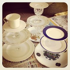 diy cake stand / etagere made from old plates and glasses or candleholders or eggcups...