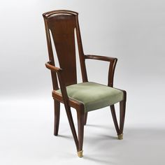 A French Art Nouveau mahogany armchair by Louis Majorelle, featuring gilt-bronze sabots and upholstered in green fabric. Similar chair pictured in: Louis Majorelle, by Victor Arwas, page 116 and in a dining room scene in Majorelle, by Roselyne Bouvier, La Bibliothèque des Arts, Paris, Publishers, page 117. Artist: Majorelle Circa: 1900