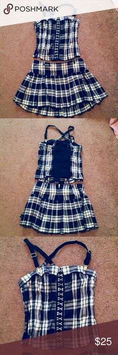 Tripp clueless outfit. Adorable skirt and top set size medium on both. Worn but in good condition. Buttons with clasps in front and has suspender like straps. This fits more of a small lady. Skirt zips in back. Hot Topic Tops Blouses
