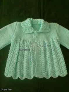 Knitted sweater with lacey collar.