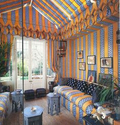 John Stefanidis: I added a conservatory to this Regency rectory.  Electrically controlled roof blinds are in the same fabric as the walls and sofas.  The fabric was specially designed and printed in yellow and blue stripes with stars. This room could be filled with sunlight or, with the curtains drawn, the pattern and colour of the fabric made the room glow - a perfect overflow space for parties. Conservatory Roof Blinds, Conservatory Ideas, Curtain Drawing, Tent Room, Glam House, Luxury Tents, Balcony Design, Street House, World Of Interiors