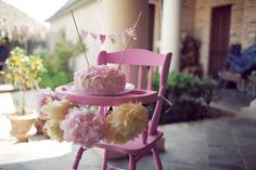 This pink and yellow, circus-themed party is beautiful! I adore the cake bunting and the lovely high chair display with poms.