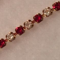 """Delicate Vintage Bracelet w Red/White Crystals 6.66"""" This little Bracelet says I Love You all Over it. Beautiful little bright red and white crystals sparkle and catch the light with every movement. Condition vintage. Thank You for visiting BlackBeards Lost Treasure App Store of Urbandale Iowa where all Treasures are Pre owned/used, examined, & researched (5>=90 hrs). We search the USA for Lost Rare Irreplaceable Treasures. All Treasures were all pre-loved and were cherished. Age < 100…"""