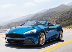 2014 Aston Martin Vanquish Volante The 2014 Vanquish Volante is every bit the supercar as its hardtop twin brother: a 5.9-liter V12 engine with 565 horsepower, carbon-fiber body panels…  But this one just happens to go topless. And who doesn't like to see a top come off in the summer heat? Unfortunately, you won't see it this summer. The Volanté goes on sale early next year.