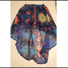 NWOT Hurley Rainbow Skirt Size Small Brand new without tags. Cute, colorful Hurley skirt. It's shorter in the front and longer in the back with an elastic waist Size small Hurley Skirts High Low
