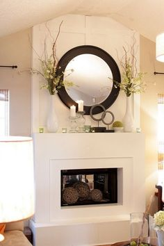 Large Mirror With Tall Twiggy Plants On Each Side   Mantel Styling