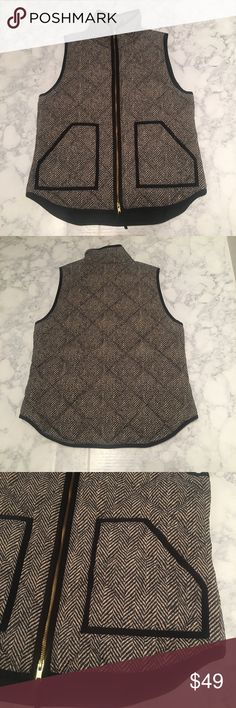 J. Crew Herringbone Quilted Vest Medium Very gently used size medium j. Crew herringbone vest.  Double zipper. Does work perfectly.  Standing collar.  Deep pockets.  Gold in color zipper 100% poly.  Purchased from J. crew, not the J. crew Factory  Not a boutique brand.  Only sign of wear/tear is the Tag has signs of blue discoloration as shown in the photo. J. Crew Jackets & Coats Vests