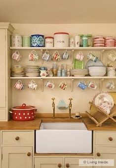 Love how this open shelving manages to look organized and pretty even though it's casual and has a lot going on. Also I like how the cabinet color is a deep off-white but isn't quite nasty beige/tan.
