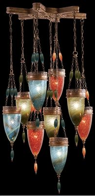 Pendant of meticulously crafted metalwork in an aged dark bronze finish. Hand-blown glass in vibrant Oasis Green, Desert Sky Blue & Sunser Red glass colors. Includes 6 additional chain.
