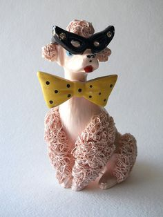 Kitschy pink spaghetti poodle with bow tie and rhinestone glasses.