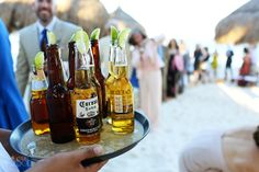 Quenching the thirst after the beach wedding ceremony at @La Zebra, Tulum in the Riviera Maya. Nothing beats an icy cold beer in paradise!  Mexico wedding photographers Del Sol Photography